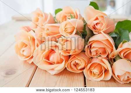 Fresh pink roses on rustic wooden background