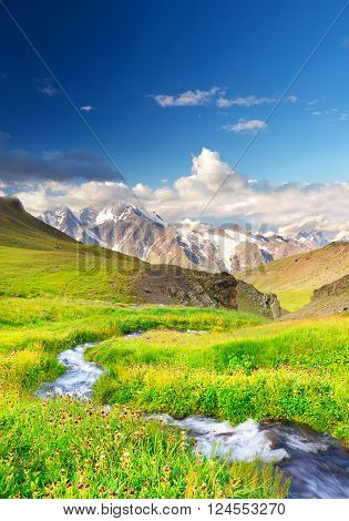 River and high mountains. Beautiful natural landscape ** Note: Visible grain at 100%, best at smaller sizes
