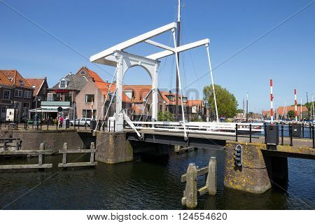 ENKHUIZEN THE NETHERLANDS - MAY 15, 2014: Draw bridge over a canal in the historic center of Enkhuizen. The city was once one of the harbour-towns of the VOC.
