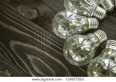 incandescent lamps on the wooden rustic background ** Note: Soft Focus at 100%, best at smaller sizes