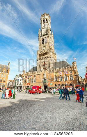 Bruges Belgium - May 17 2014: Ancient medieval tower with clock in The belfry of Bruges or Belfort is a medieval bell tower in the historical centre of Bruges.