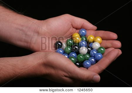 A Hand Full Of Marbles
