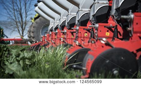 Agricultural machinery in agricultural fair on green grass