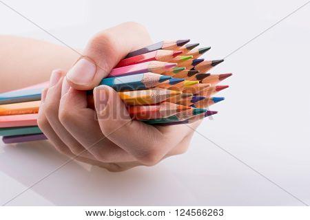 Hand Holdin Pencils
