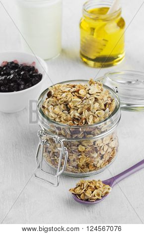 Breakfast: Granola, Yogurt, Honey, Blueberry On A White Background
