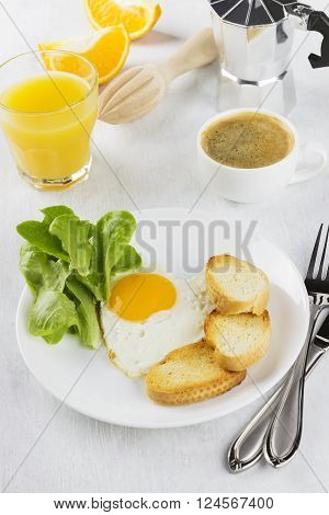 Breakfast: Fried Eggs With Greens, Orange Juice, Coffee On A White Background