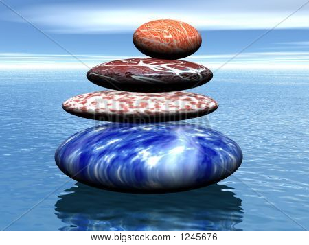 Stack Of Balanced Stones On The Sea