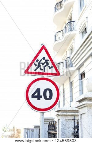 Signs - Slow down. Children crossing. Traffic road sign in the city