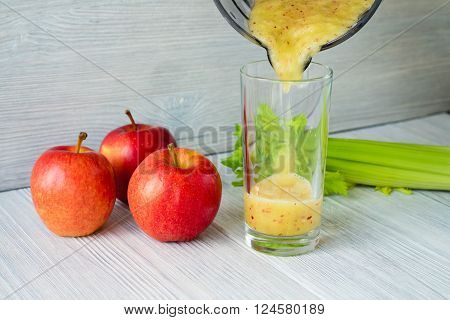Smoothies Made From Apples And Celery Poured Into A Glass