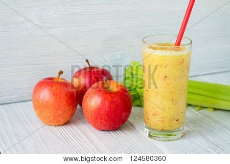 Smoothies Made From Apples And Celery In A Glass With A Straw On A Table