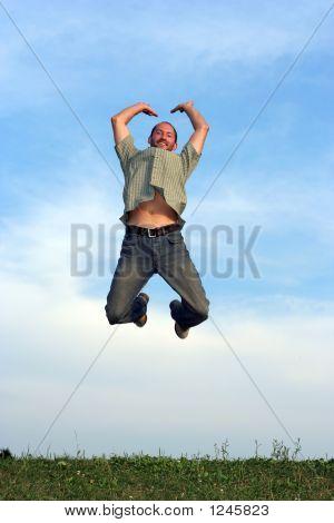 Man Jumping Over Grass