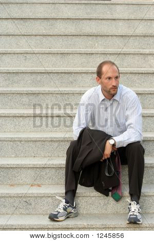 Relaxed Business Man On Stairs
