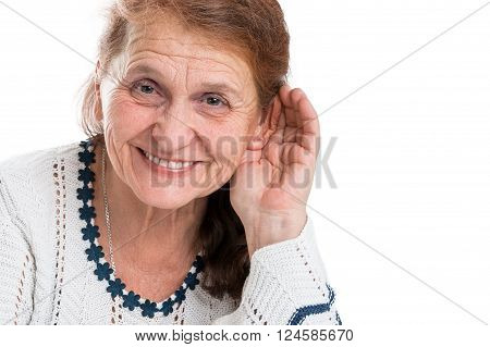 The old woman who rejoices that can hear. Portrait of a happy old woman on a white background