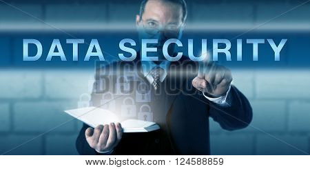 Chief Information Security Officer or auditor is pushing DATA SECURITY on a visual screen. Business metaphor and information technology concept for the protection of data via encryption techniques.