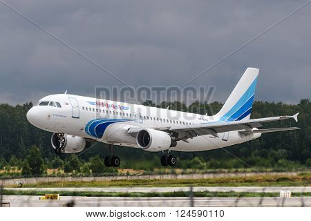 DOMODEDOVO RUSSIA - JULY 20: Aircraft operated by JSC Yamal Airlines take off from Moscow airport in Domodedovo on July 20 2013. The company in its fleet has 7 aircraft Airbus 320-200