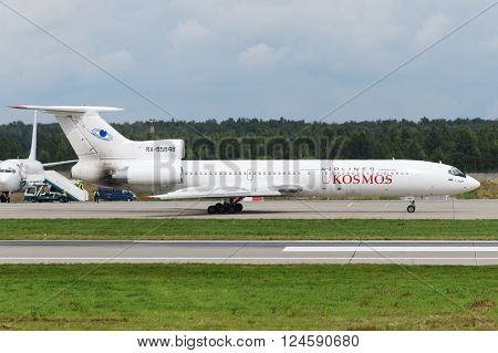 DOMODEDOVO RUSSIA - JULY 20: Aircraft operated by Kosmos ready to take off at Moscow airport Domodedovo on July 20 2013. The company in its fleet has 4 aircraft Tu-154