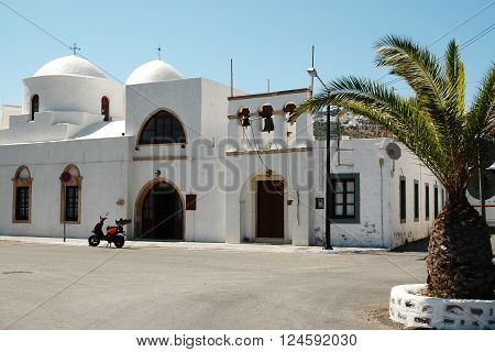 PATMOS, GREECE - JUNE 13, 2005: Church on the square near the harbor on the Greek island of Patmos
