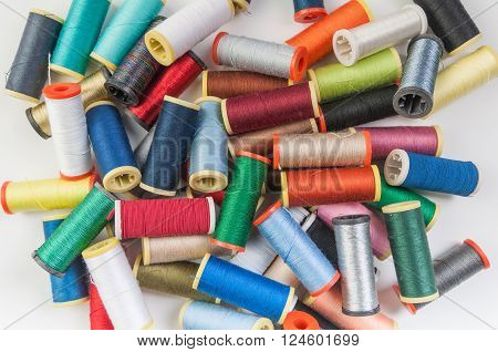 A mixture of colourful spools of thread