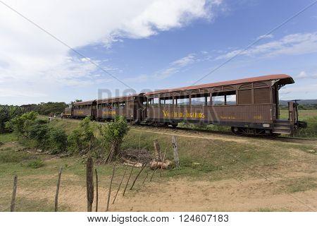 Manaca Iznaga Cuba - January 2 2016: tourist train Valle de Los Ingenios Manaca Iznaga Sancti Spiritus Province Cuba