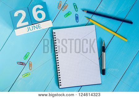 June 26th. Image of june 26 wooden color calendar on blue background. Summer day. Empty space for text. International Day against drug abuse and illicit trafficking.