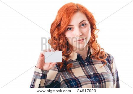 Close-up portrait of young smiling woman holding credit card isolated on white background