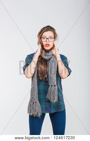 Scared young woman looking camera isolated on a white background