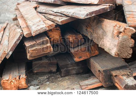 Heap of old wood planks from end view.