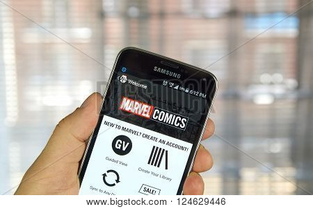 MONTREAL CANADA - APRIL 5 2016 : Marvel Comics app on a cell phone. Marvel Comics is a comic book publishing house famous for creating notable characters such as Spider-Man Captain America etc.