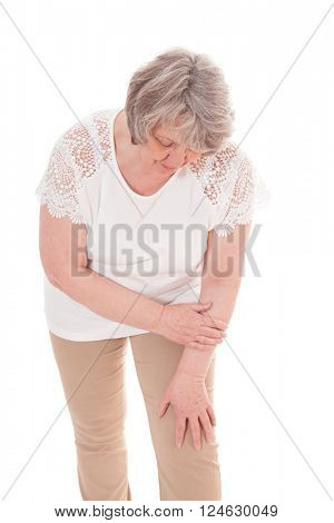 Senior woman suffers from arthrosis. All on white background