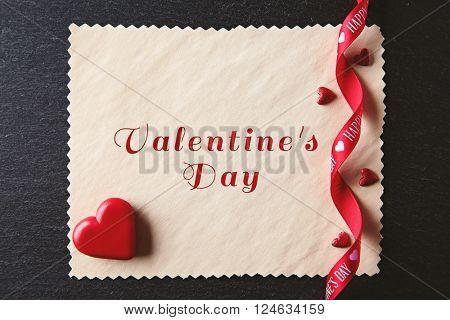 Blank present Valentine card on black textured background