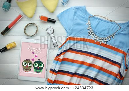 Colourful fashion look on wooden background, close up