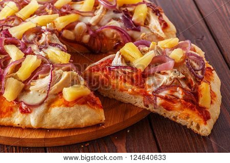 Hawaiian pizza on a dark background selective focus.