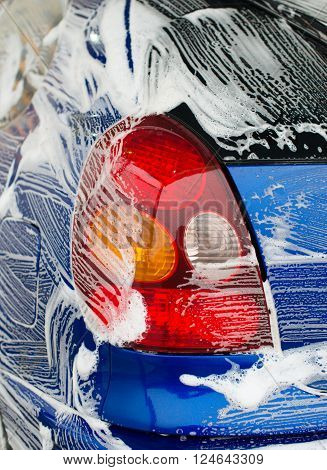 Blue car wash at automatic car-wash service. ** Note: Visible grain at 100%, best at smaller sizes