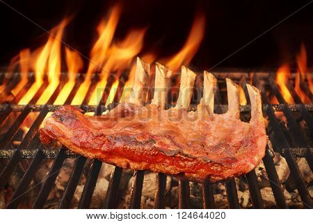 Marinated With BBQ Sauce Pork Spare Rib On The Hot Charcoal Grill With Bright Flames In The Background Close Up poster