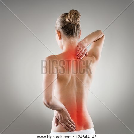 Lumbago and backbone stretch concept. Painful woman's back