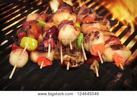 Vegetarian Vegetables Kebabs Barbecuing On The Hot Flaming Charcoal BBQ Grill