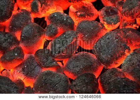 Barbecue Grill Pit With Glowing And Flaming Hot Charcoal Briquettes