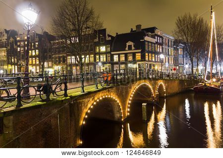 Amsterdam canal and bridge at night, The Netherlands
