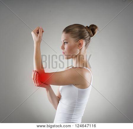 Young girl having hurt elbow. Bone dislocation concept.