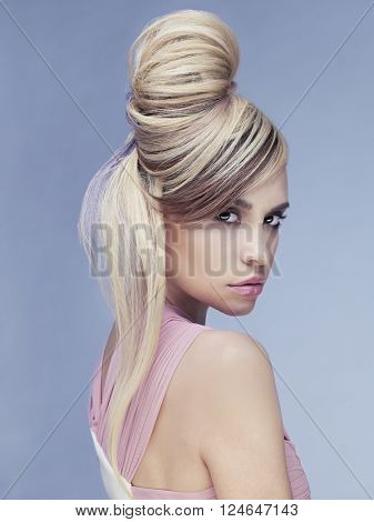 Erotic portrait of young beautiful woman. Sexy blonde.