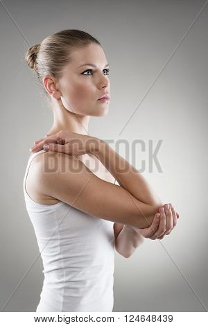 Young woman with injured elbow. Sprain treatment or therapy concept.