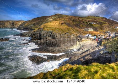 English coast village with waves Trebarwith Strand Cornwall England UK between Tintagel and Port Isaac in colourful HDR