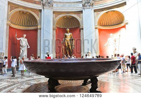 VATICAN-JULY 20: Sala Rotonda with bronze sculpture of Herculeson in Pius-Clementine Museum on July 20 2010 in the Vatican Rome Italy.