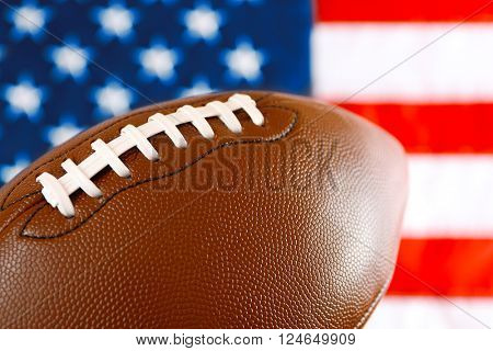 Rugby ball on background of American flag. Popular sport concept