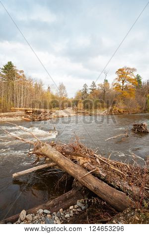 Destroyed road wooden bridge in the distant taiga area. Autumn, Far East Russia.