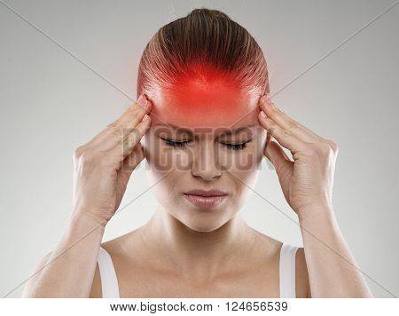 Woman having headache or dizziness problem. Health care and treatment concept.