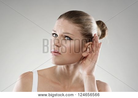 Deafness and ear disease. Young woman having hearing problems. Health care and hospital treatment concept.