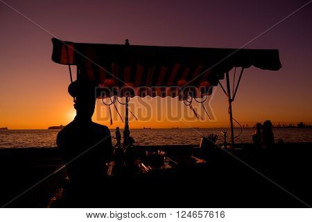 Man selling icecream on the harbor of Thessaloniki in Greece