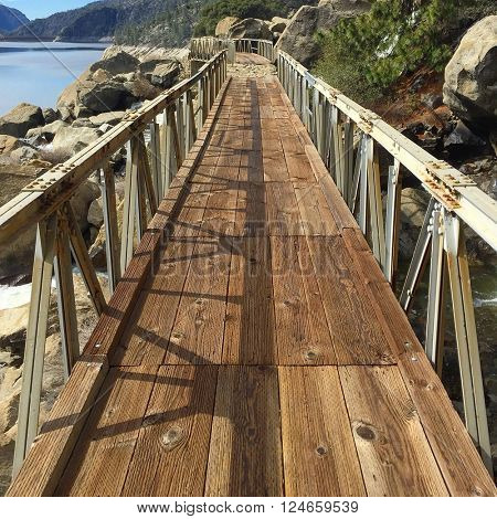 Footbridge over Wapama Falls at in the Hetch Hetchy Valley, California