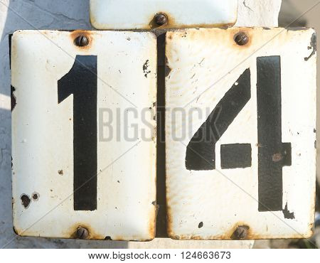Number Fourteen On The Metall Plate